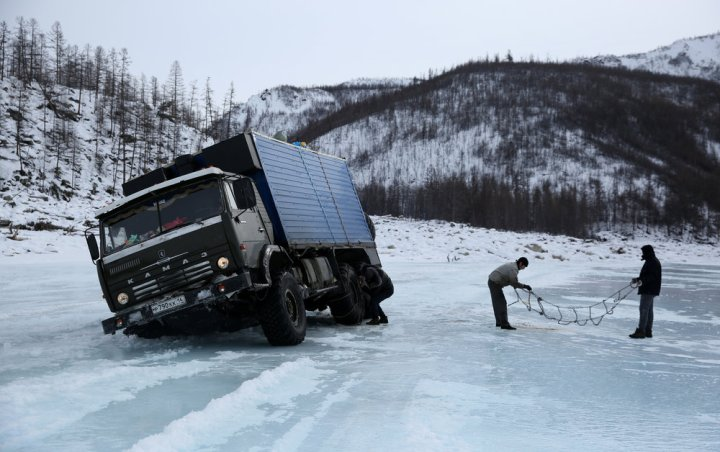 A truck after nearly breaking through on one of Siberia's treacherous ice highways. Click  here  for the story of the terrifying journey made by one man to deliver food some of the world's most isolated villages.
