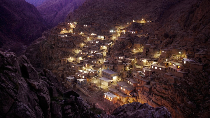 Iran's Palangan Village, twinkling to light at dusk. Click  here  for the full gallery on Iran.