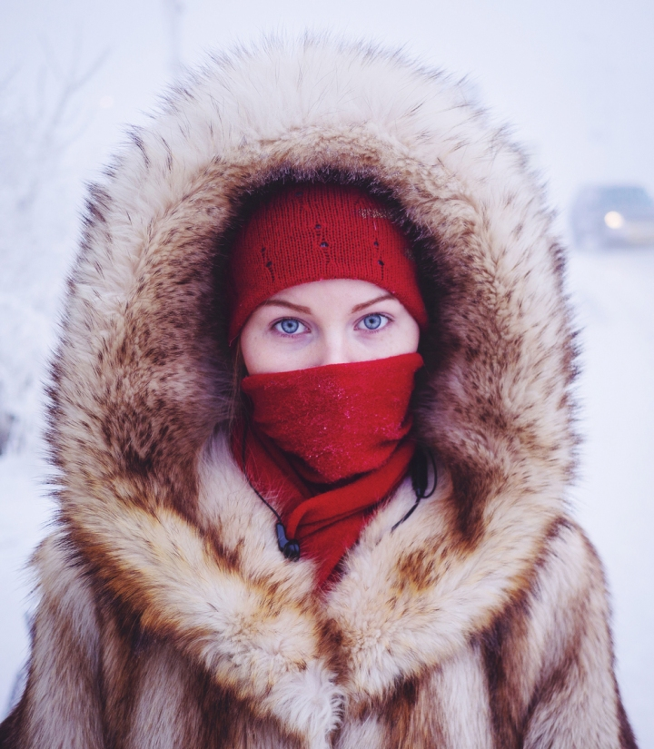 Husky-eyed student waiting for her bus in Yakutsk, the coldest city on earth.