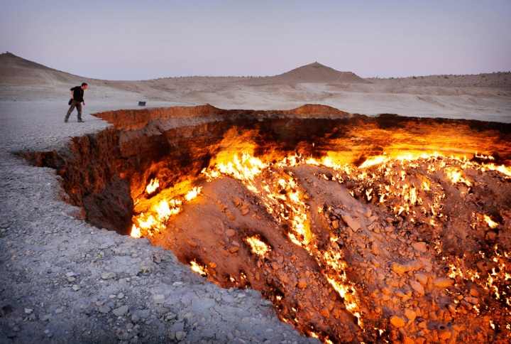 Turkmenistan's Darvaza gas crater. In the 1970s, Soviet engineers accidentally collapsed this cavern while exploring for gas in the Karakum Desert. The escaping methane was lit to avoid poisoning nearby villages. It has been burning ever since. Click  here  for a glimpse of Turkmenistan's mad world.