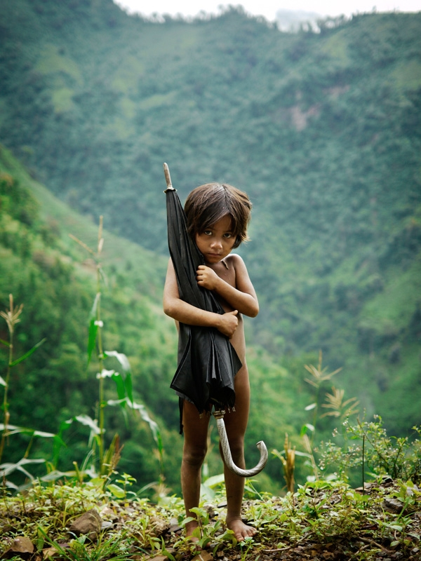 A girl from the Chepang tribe in the highlands of southern Nepal. The girl was on her way to guard a corn crop against monkeys.