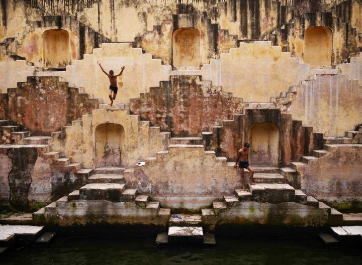 Local boys leap into a stepwell near Jaipur's Amber Fort.