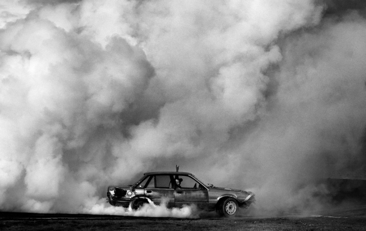 Barry Marriner tears through the tyres of his old Holden during the annual burnout contest in Huntly, rural New Zealand.