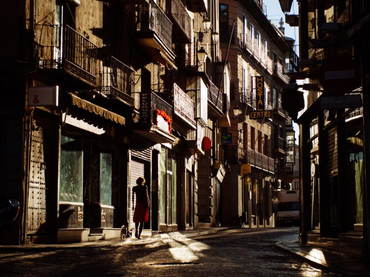 On the way to the bakery in clear morning sunlight, Toledo.