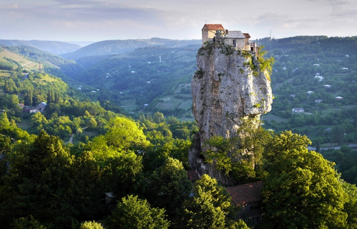 """The Katskhi Pillar, Georgia. A monk (standingdirectly under the terracotta roof)has lived atop the pillar for the past 21 years in order to live """"closer to God"""". Click  here  for the story."""